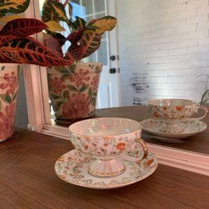 Napco Tea cup and saucer. Orange floral pattern